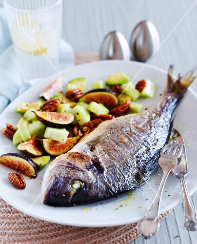 Crispy baked sea bream with cucumbers, figs and pecan nuts