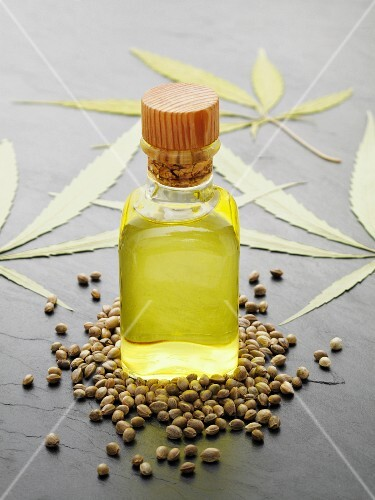 Hemp oil with seeds and leaves