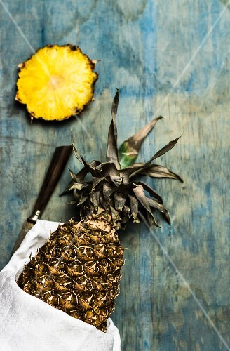 Sliced pineapple on a blue wooden surface