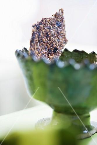 Sesame seed crispbread in a green bowl