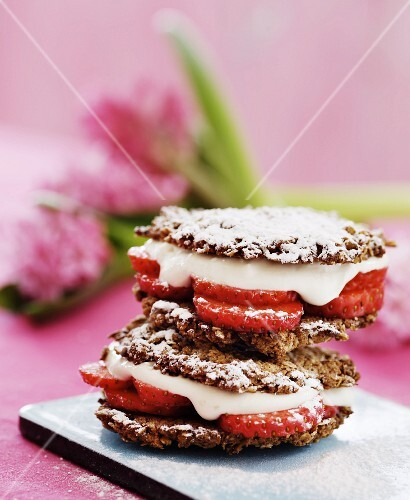 Oat biscuit sandwiches with strawberries and vanilla cream
