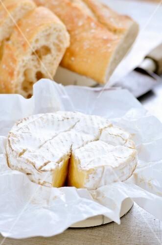 Sliced Camembert and baguette