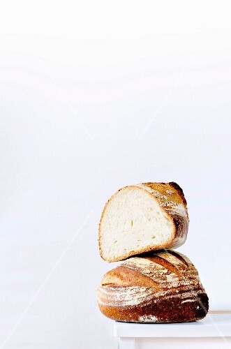 Two chunks of bread one on top of the other