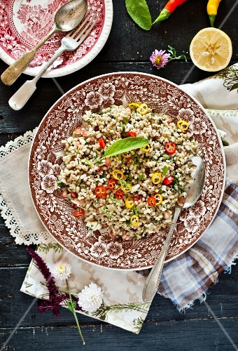 Barley salad with chilli rings and lemon zest