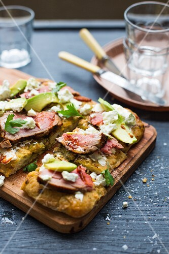Grilled foccacia with goat's cream cheese, roasted beef fillet, avocado and parsley