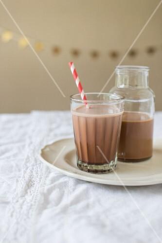 Warm chocolate milk with melted chocolate, cream and vanilla