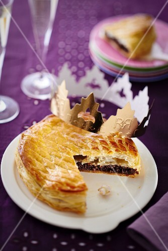 Puff pastry chocolate cake, sliced, decorated with a crown