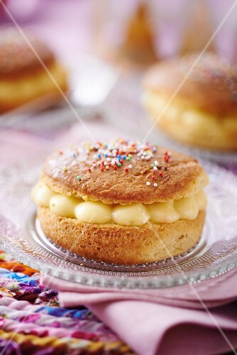 A mini Tarte Tropezienne with colourful sugar sprinkles (France)