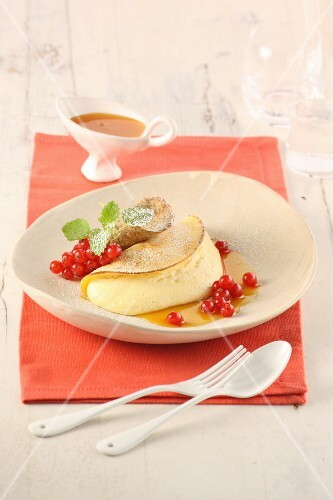 Souffléd crêpes in orange syrup with redcurrants and poppyseed wafers