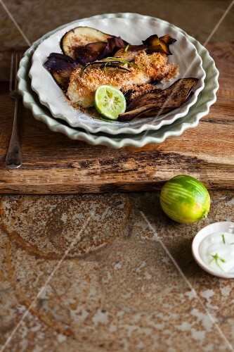 Fried monkfish fillet with a coconut crust, aubergine crisps and lime mayonnaise