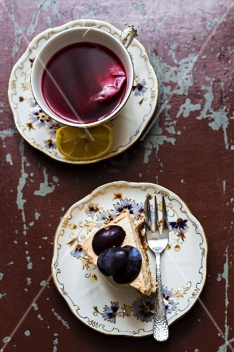 A cup of fruit tea and a slice of plum cake