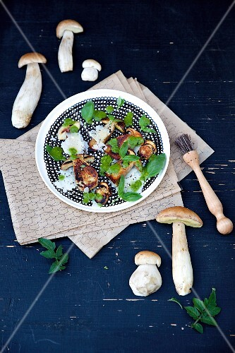 Fried porcini mushrooms with Parmesan cheese and basil oil