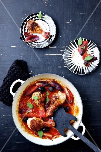 Pollo alla cacciatora with tomato sauce and olives (Italy)