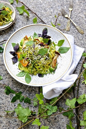 Courgette pasta with mushrooms, avocado, bean sprouts and Thai basil