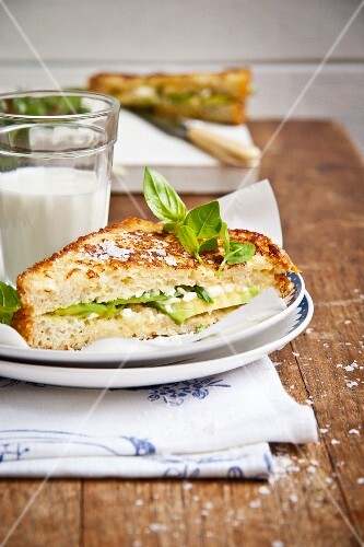 French toast with avocado, feta cheese and basil served with a glass of milk