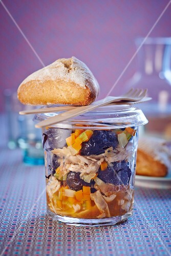 Rabbit with plums and vegetables in a jar