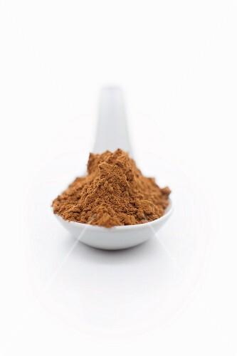 Carob powder on a spoon