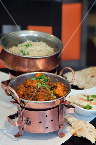 Chicken curry with parsley, rice and Indian naan bread