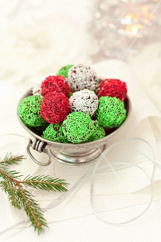 Christmas truffles with white, green and red sugar sprinkles
