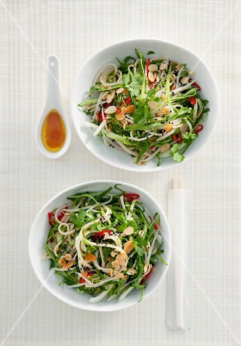 Oriental bok choy with noodles and flaked almonds