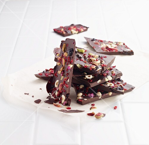 Broken chocolate with nuts and dried berries