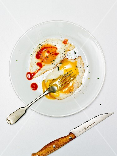 Fried egg with ketchup (seen from above)