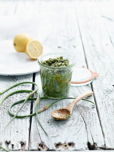 Salsa verde in a glass on a wooden table