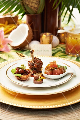A Caribbean appetiser platter with Ahi tuna poke and chicken legs