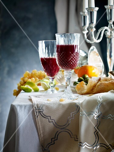 Mulled wine and fruit on a table laid for Christmas