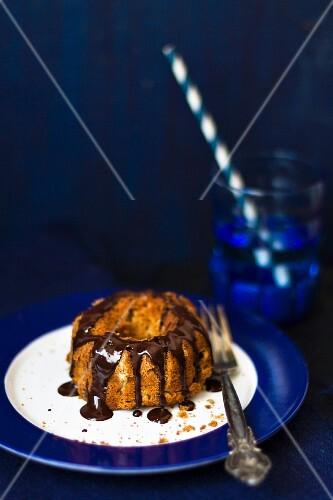 A mini Bundt cake with chocolate sauce