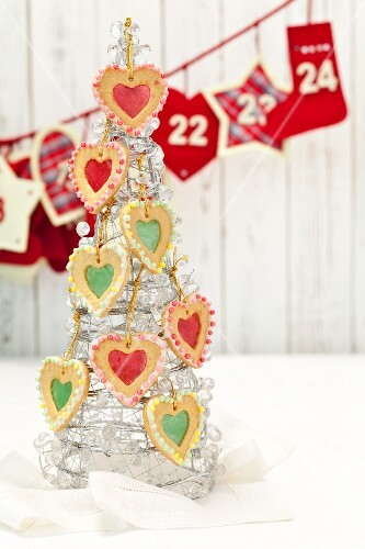 Shortbread hearts with sugar windows hung on a glass Christmas tree