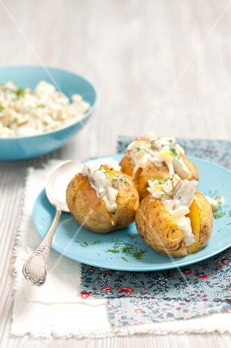 Baked potatoes with herring salad