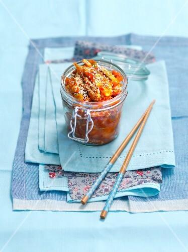 Kimchi with sesame seeds in a preserving jar (Korea)