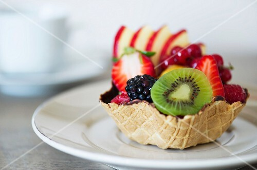 A fruit tartlet on a white plate