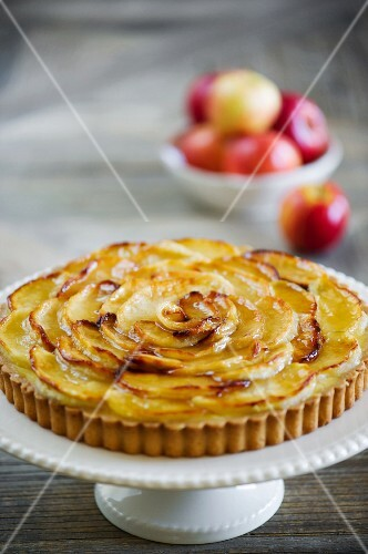 An apple tart on a cake stand