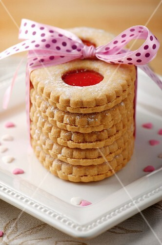 Jam sandwich biscuits tied with a pink ribbon