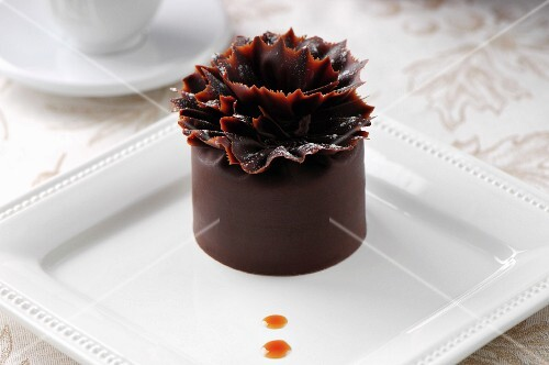 A rich chocolate cake on a white plate