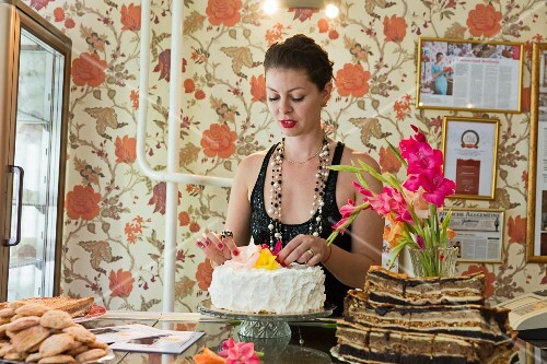 Rachel Raj has a television cookery show and three bakeries where she sells cake and Jewish layer cakes made with poppyseeds, Budapest, Hungary