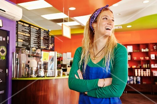 A happy waitress in a cafe