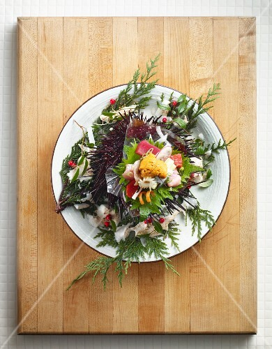 Sea urchin sashimi with edible flowers (Japan)