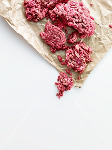 Minced beef in a piece of crinkled paper