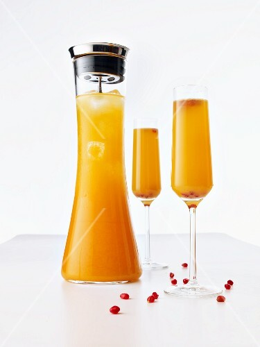 Christmas champagne cocktail in a glass and in a carafe