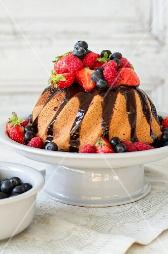 Bundt cake with chocolate sauce and berries