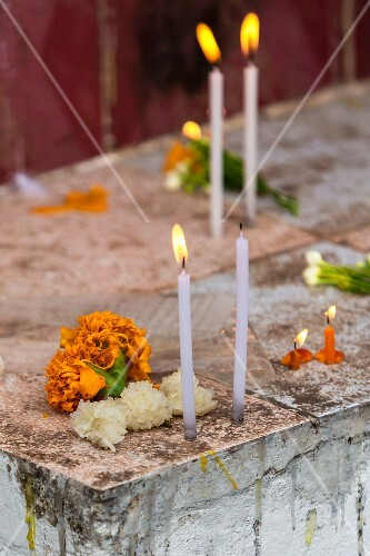 Sticky rice, flowers and candles in a temple (Vientiane, Laos)
