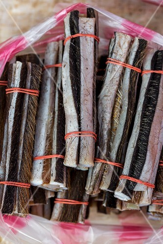 Strips of buffalo skin used for cooking at a market (Vientiane, Laos)