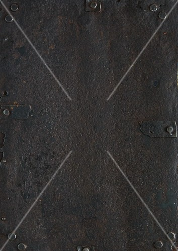 An iron surface with rivets