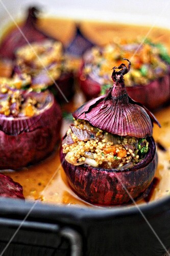 Red onions filled with couscous, dried apricots and herbs