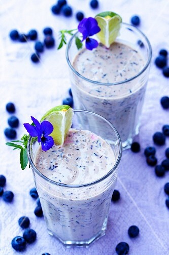 Two blueberry and lime milkshakes