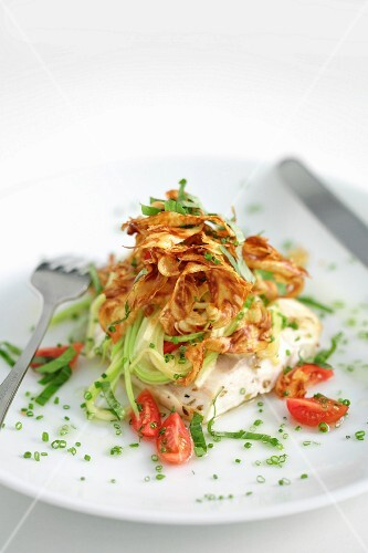 A sea bass with fried artichokes and courgettes