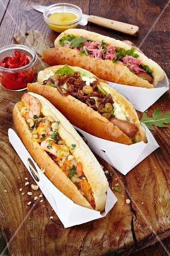 Three different hot dogs (classic, Thai and cheese)
